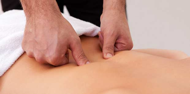 Chiropractor analyzing the back of patient