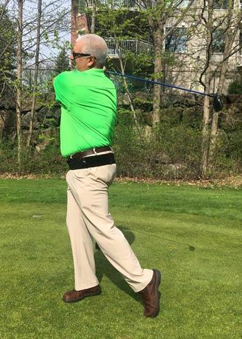 Revolution Back Belt being worn by a golfer