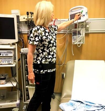 Revolution Back Belt being worn by a patient
